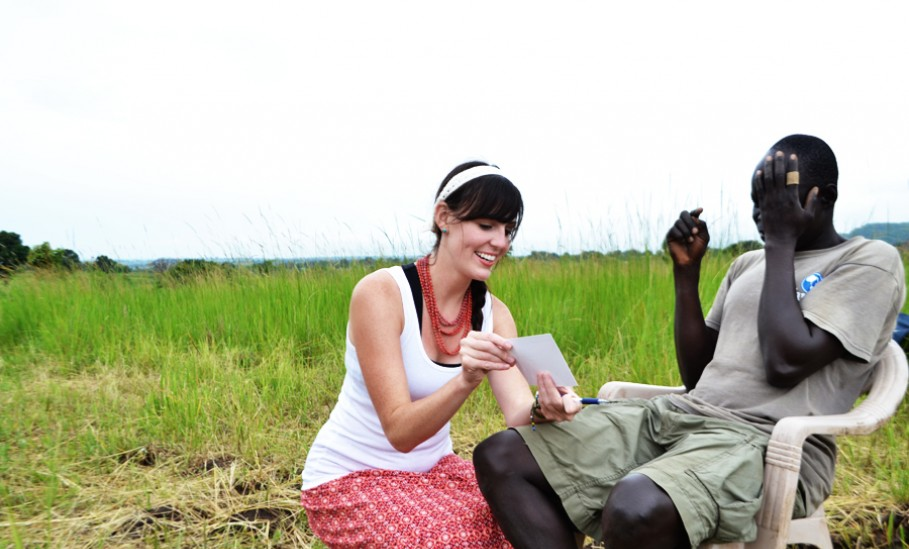 Kristen from East African Ministries performs vision test in a field in Wudu